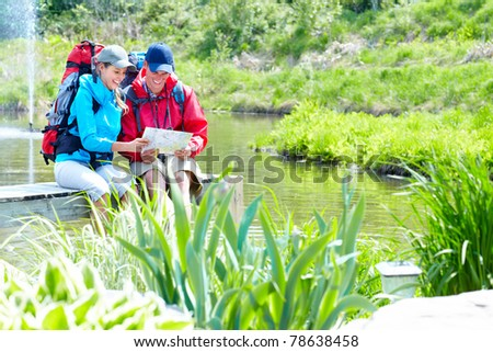 Couple tourists with backpacks outdoors. Adventure. Tourism. - stock photo