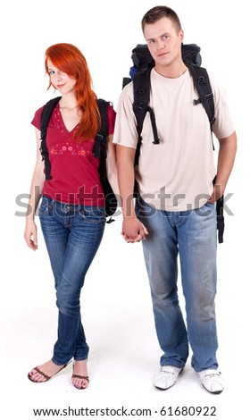 couple tourists, woman and man, with backpacks - stock photo