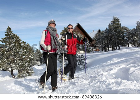 Couple trekking through snow