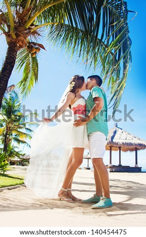 Couple under the palm tree