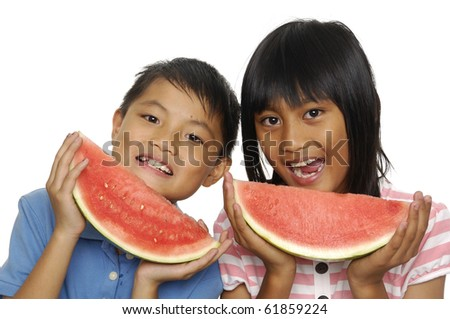 Couple up little couple eating watermelon - stock photo