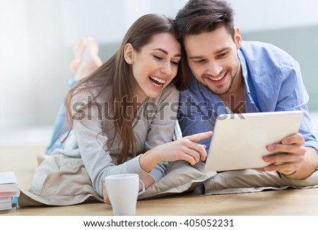 Couple using digital tablet together  - stock photo