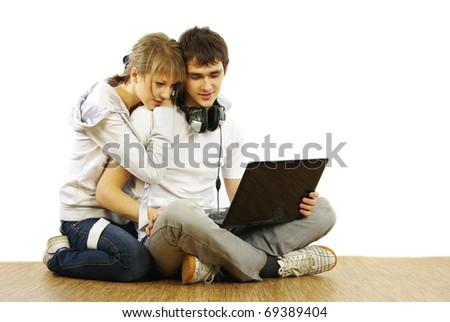 Couple using laptop - stock photo