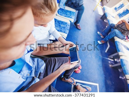 couple using smart phone in a bus. Template for an app design - stock photo