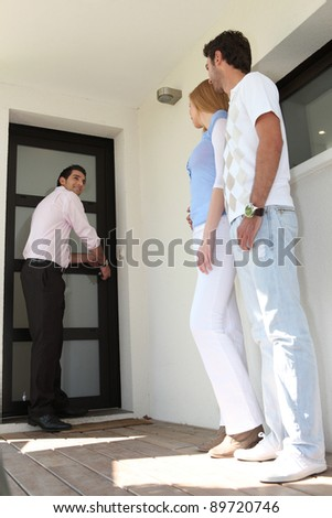 couple visiting their new apartment - stock photo
