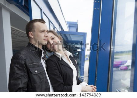 Couple waiting for the flight - stock photo
