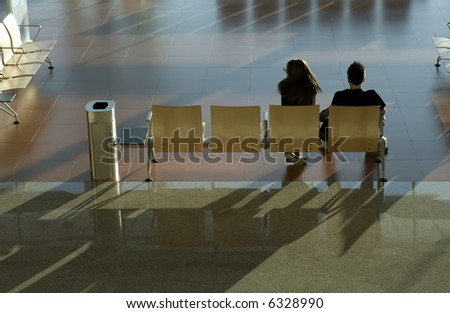 couple waiting in the airport - stock photo