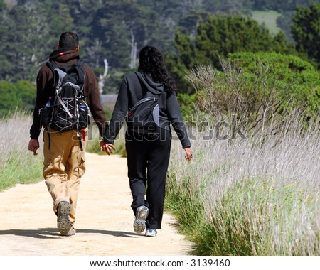 Couple Walking A Trail Through Anyo Nuevo California State Reserve - stock photo