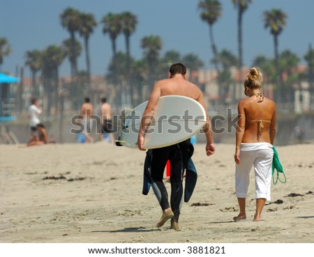Couple Walking ALong Beach in Southern California - stock photo