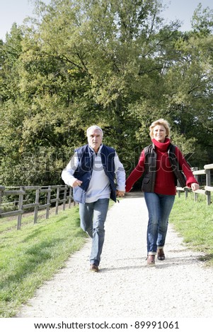 Couple walking along footpath - stock photo