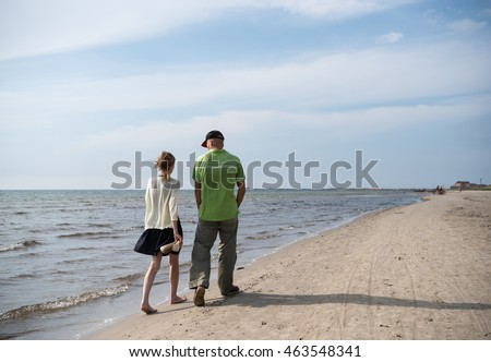 Couple walking and enjoying summer time at the beach