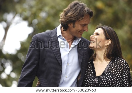 Couple walking and looking each other - stock photo