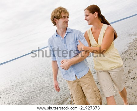 Couple walking at beach - stock photo