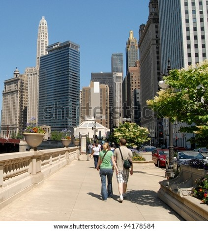 Couple Walking at Downtown Chicago, Illinois USA - stock photo
