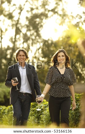 Couple walking at sunset - stock photo