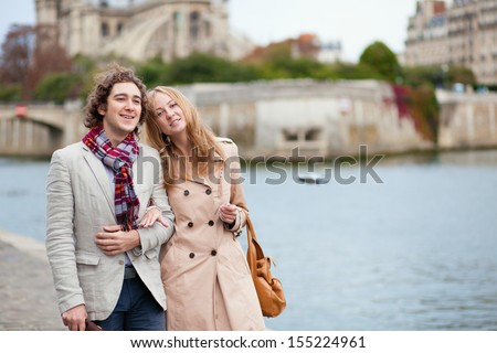 Couple walking by the Seine in Paris - stock photo