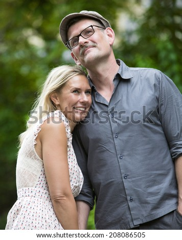 couple walking in a park and smiling