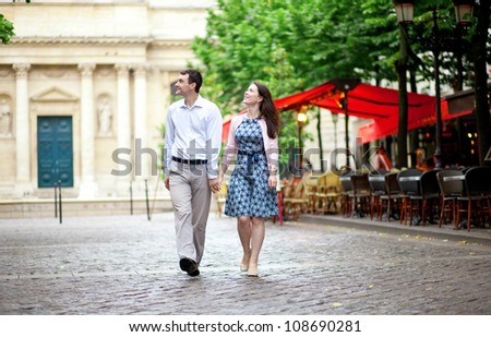 Couple walking in Paris near a street cafe - stock photo