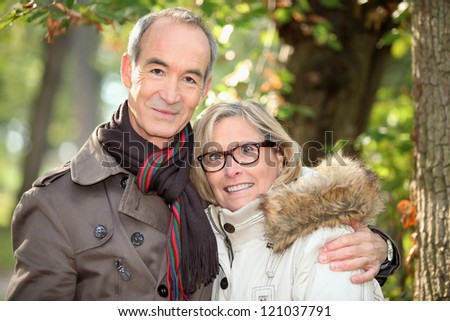 Couple walking in the woods - stock photo