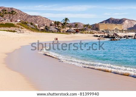 Couple walking on beach in Cabo San Lucas, Mexico - stock photo