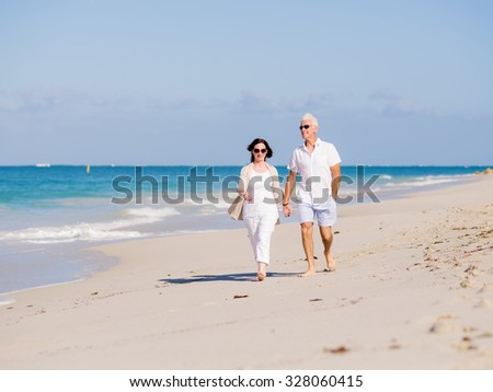 Couple walking on the beach