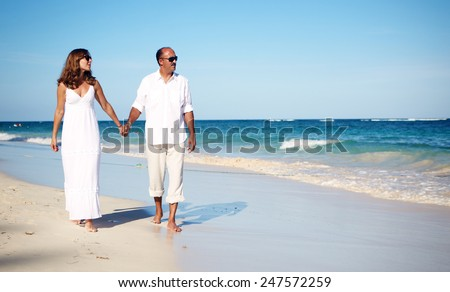 Couple walking on beach tropical resort stock photo for Tropical vacations for couples