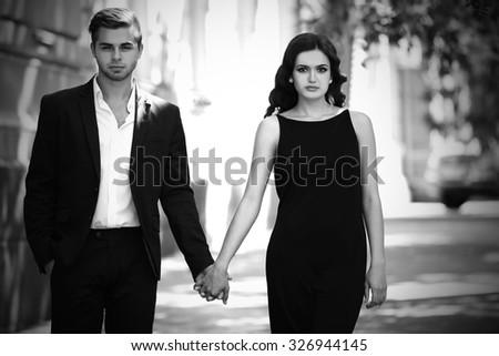 Couple walking on the street - stock photo