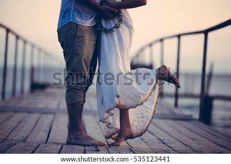 Couple walking seaside, love story concept near sea, walking and holding each others hands,