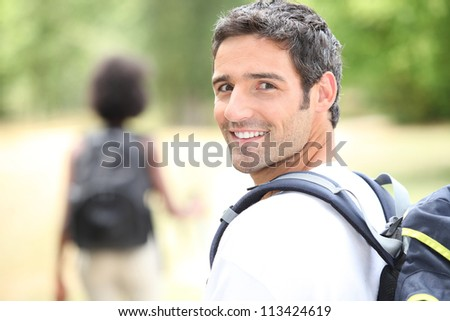 Couple  walking through the countryside - stock photo