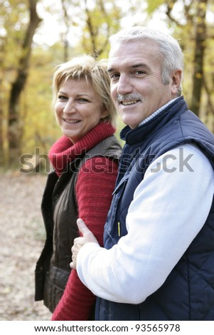 Couple walking through woods