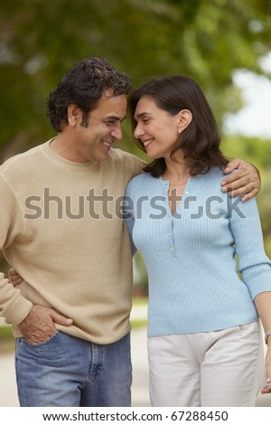 Couple walking together - stock photo