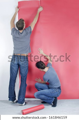 Couple wallpapering - stock photo