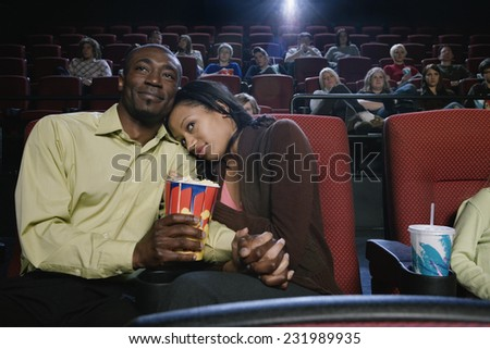 Couple Watching a Movie in Theater - stock photo