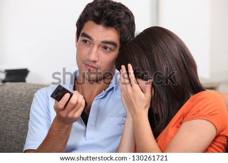 Couple watching an horror movie. - stock photo