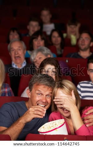 Couple Watching Film In Cinema - stock photo