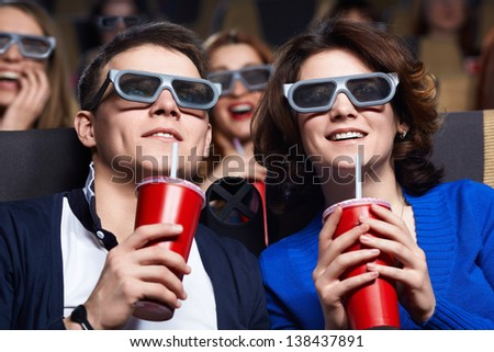Couple watching movie at the cinema - stock photo