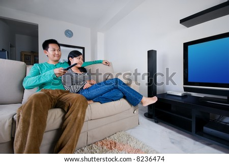 Couple watching movies together - stock photo