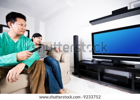 Couple watching movies together
