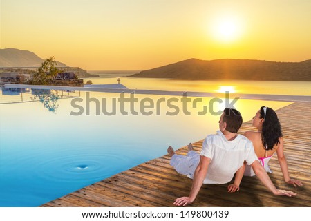 Couple watching together sunrise in Greece - stock photo