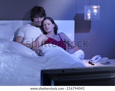 Couple watching TV. - stock photo