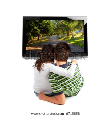 Couple watching TV - rear view - isolated on white - stock photo