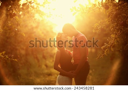 Couple wayting a baby in sunset - stock photo