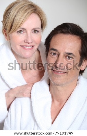 Couple wearing bath robes