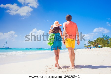 Couple wearing bright clothes on a tropical beach on Barbados