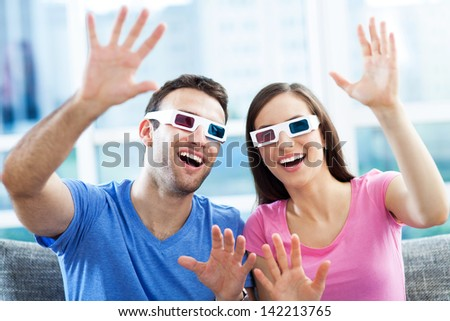 Couple wearing 3d glasses - stock photo