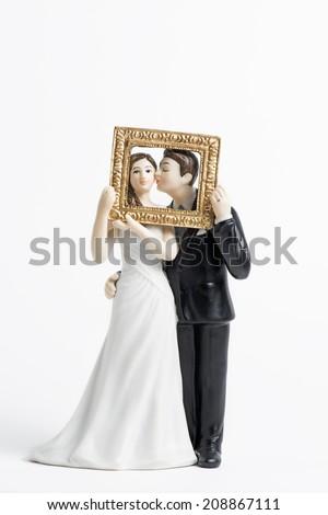 Couple wedding cake topper isolated on white - stock photo