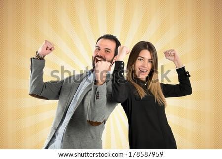 Couple winner over ocher background - stock photo