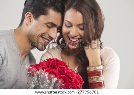 Couple with a bouquet of flowers - stock photo
