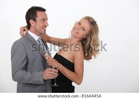 Couple with a glass of champagne - stock photo