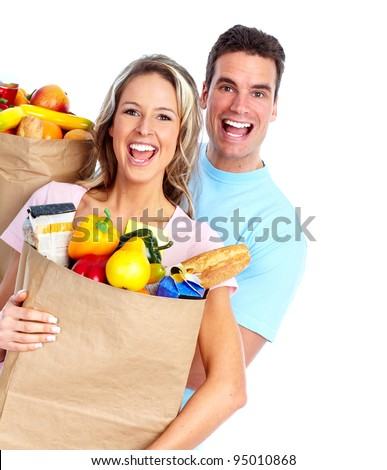 Couple with a grocery bag. Isolated over white background. - stock photo